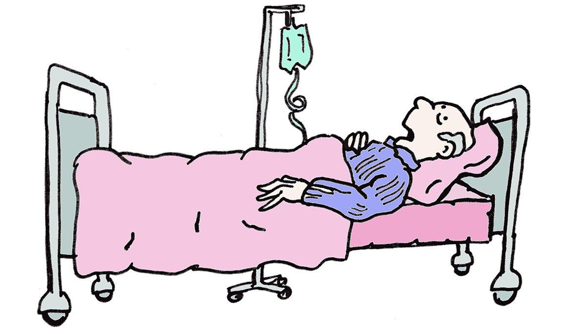 Senior im Patientenbett